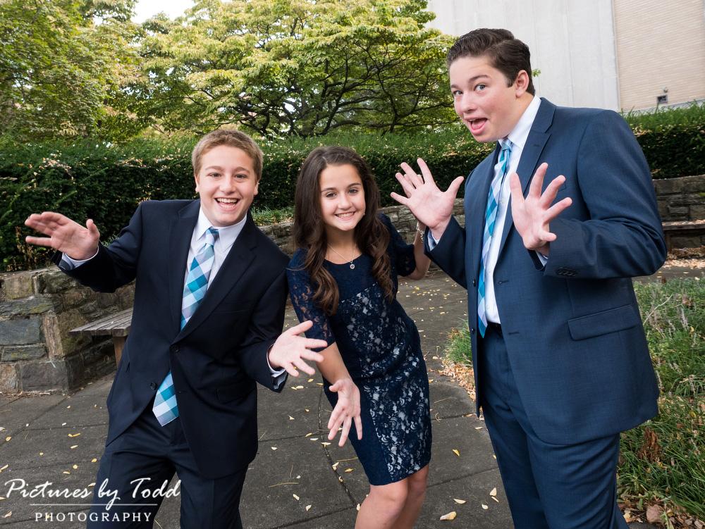 bat-mitzvah-siblings-funny-goofy-outside-happy