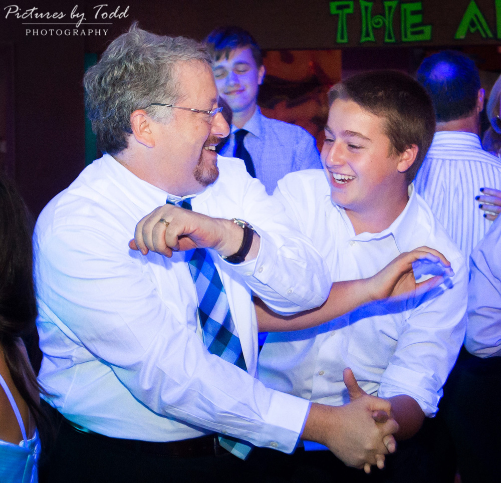 family-fun-bat-mitzvah-smile-moment-candid-father-son
