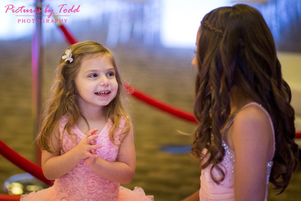 bat-mitzvah-sweet-sisters-pink-dress-indoor-candid